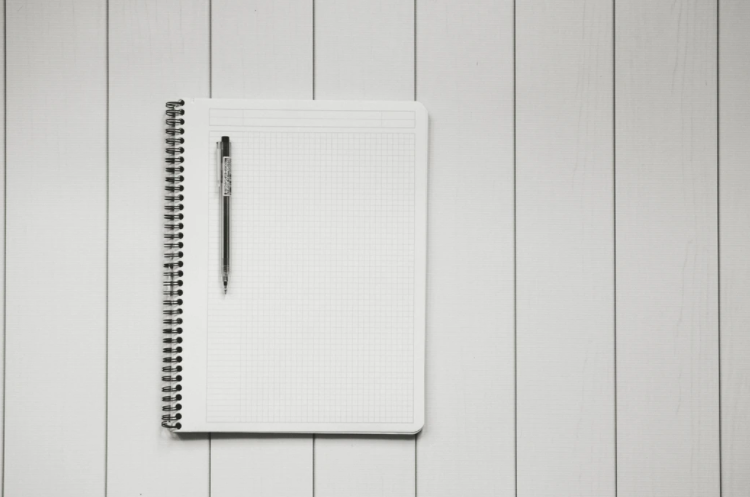 notebook and pen for writing small business blog ideas